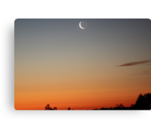 A slither of moon, over the sunset. Canvas Print