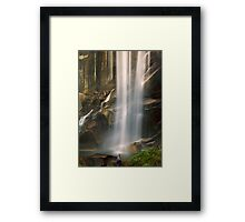 An afternoon by the waterfall. Framed Print