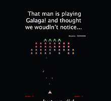 That man is playing galaga and thought we wouldnt notice... but we did. by SherlockReader1