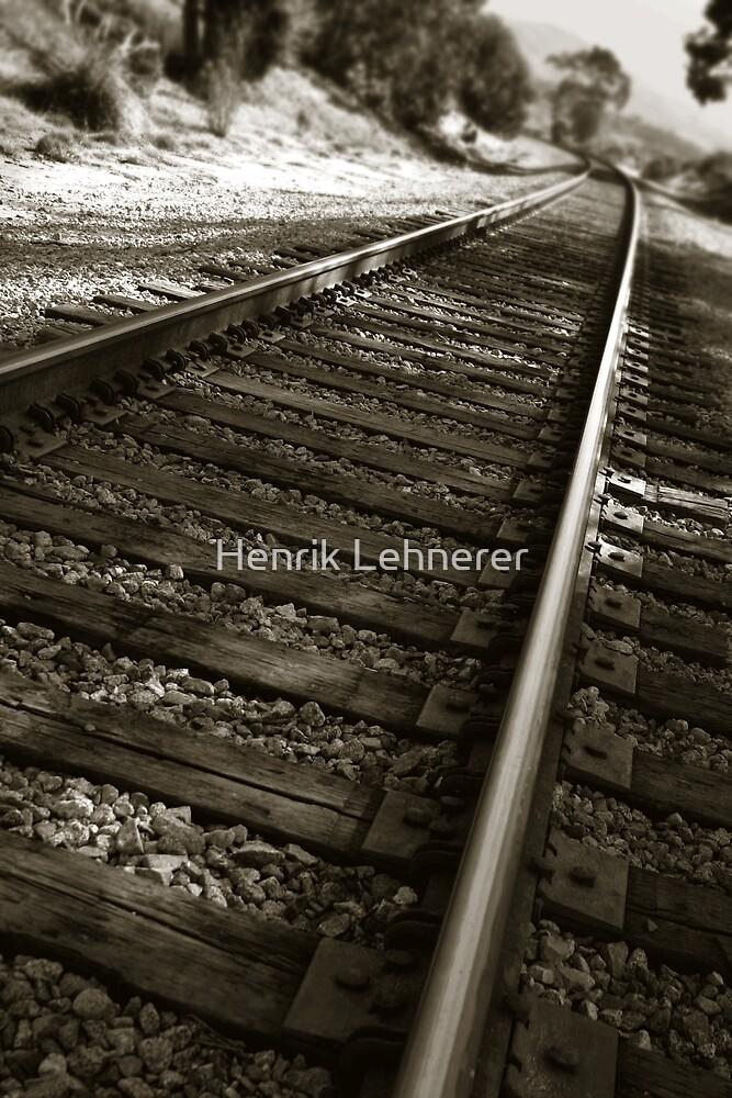 Railroad Tracks by Henrik Lehnerer