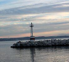 a beacon under a red, blue sky by mkokonoglou