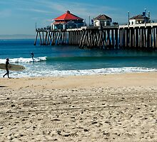 Surfers at Huntington Beach. by philw