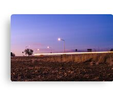 Driving Past at Sunset Canvas Print