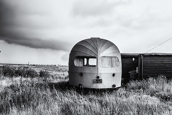 Old Winnebago left on beach by eyeone