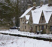 Winter in a pretty Cotswold Village by Sue Gurney