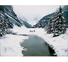 Lake Louise under a snow filled sky Photographic Print