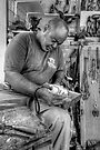 Wood Sculptor at work in Nassau, The Bahamas by Jeremy Lavender Photography
