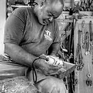 Wood Sculptor at work in Nassau, The Bahamas by 242Digital