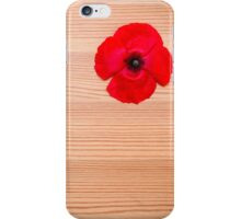 background of Red flower on wood  iPhone Case/Skin