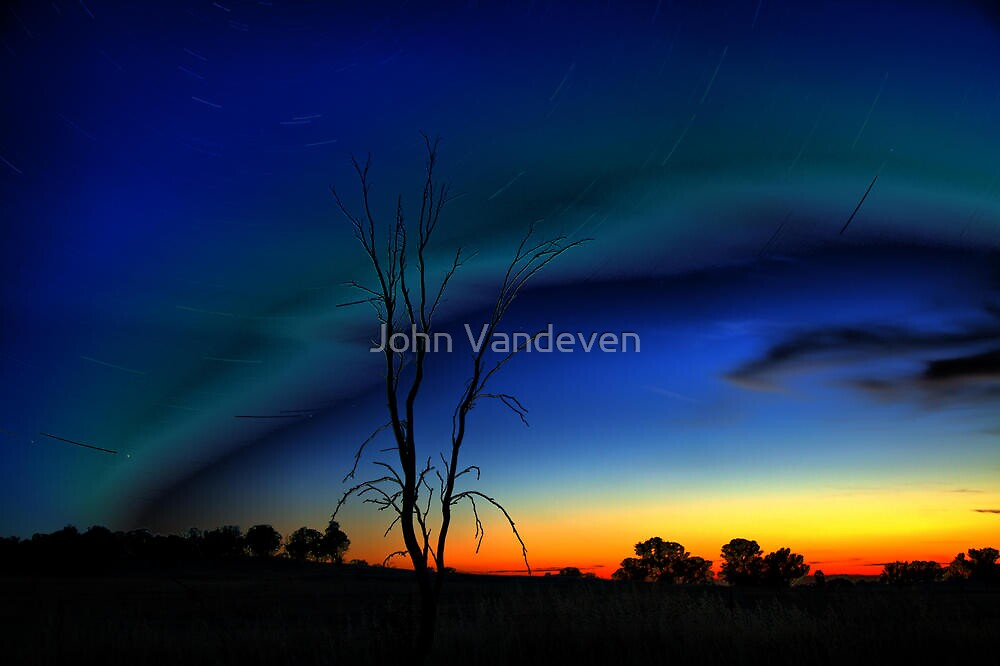 Night and sunset by John Vandeven