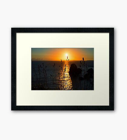 beautiful sunset over the virgin rock grass Framed Print