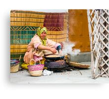 Moroccan lady helps make argan oil Canvas Print