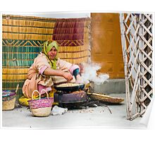 Moroccan lady helps make argan oil Poster