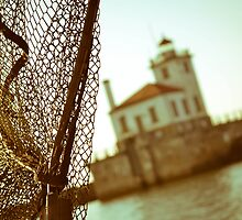Passing by the Oswego lighthouse by Jonathan Evans