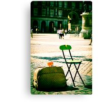 An empty chair in a big plaza Canvas Print