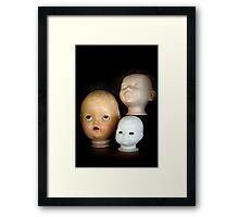 Doll Heads (vertical) Framed Print