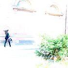 walking girl, hair in the wind  by deThierry