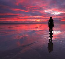 Sunset on one of Gormley's statues on Crosby Beach by Martin Lawrence