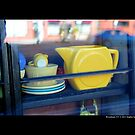 Yellow Teapot In Window Display - Riverhead, New York by © Sophie W. Smith