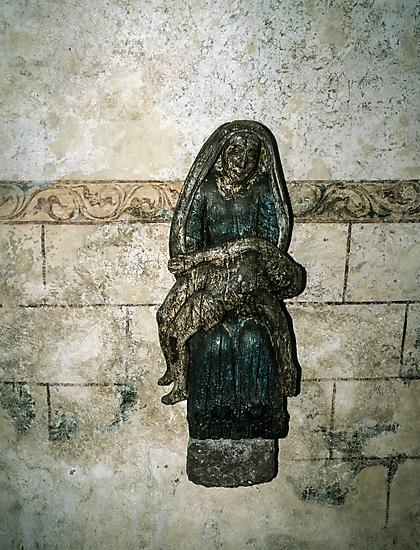 Pieta on wall of  ruined Hambaye Abbey Church 1124 198402190044  by Fred Mitchell