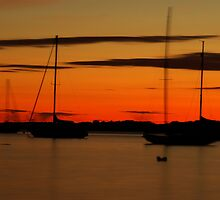 Sailboat Silhouettes at Sunset by mcdonojj