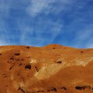 Crossed stripes on red rock and blue sky, Utah by Claudio Del Luongo