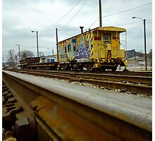 A Yellow Tagged Caboose Photographic Print