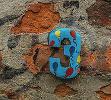 Number three on a house wall by JPopov