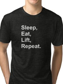 Sleep, eat, lift, repeat. Tri-blend T-Shirt