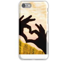 The Eiffel Tower in Paris and hands in a heart shape iPhone Case/Skin