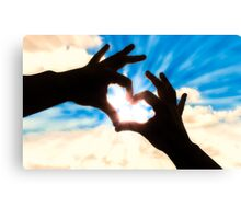 Silhouette hands in heart shape and blue sky Canvas Print