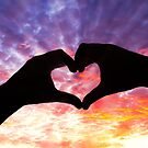 Silhouette hand in heart shape and beautiful sky by gianliguori
