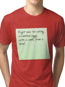 Scrambled egg, with a comb, from a shoe! Tri-blend T-Shirt