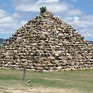 Pyramid of rocks by Judy Woodman