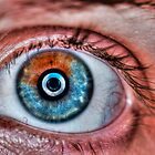 Extreme closeup of a human eye brown, and blue by PhotoStock-Isra