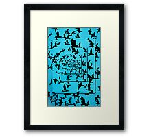 Set of silhouettes of birds on a blue background Framed Print