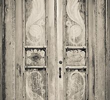 The door of the white building at the entrance to the Royal Rock Temple complex location Dambulla by Inez Wijker
