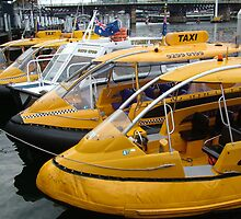 Yellow Cabs - Darling Harbour by Gary Kelly