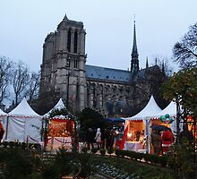 Christmas market in the shadow of Notre Dame by Justine Armstrong