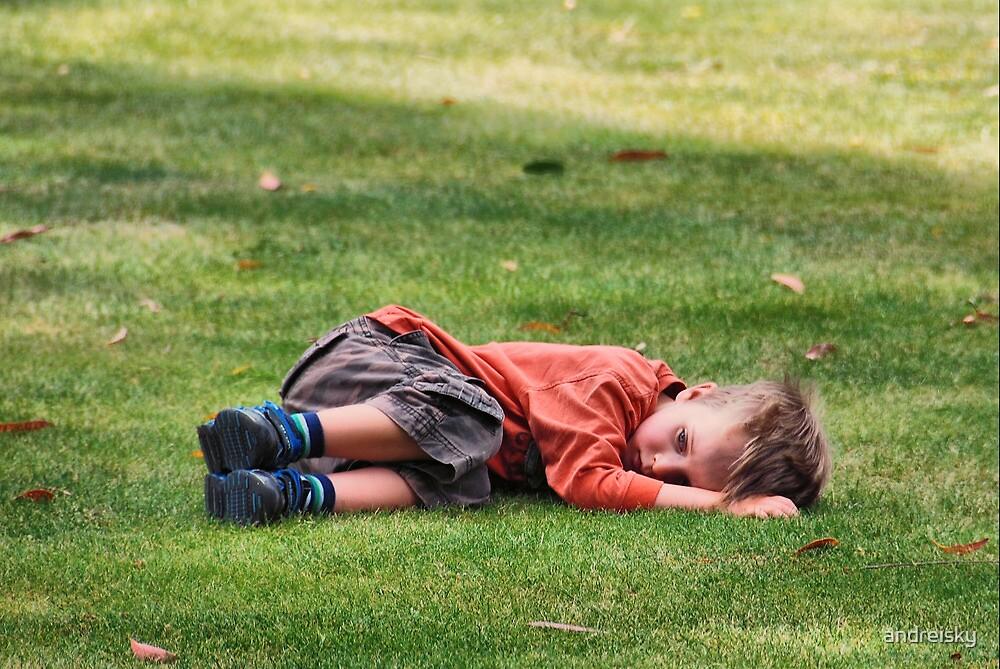 A little sad boy on the grass by andreisky