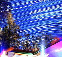 Space Star Trails Above Trees and Red Cabin  by Gavin Heffernan
