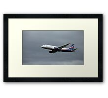 A320 in flight Framed Print