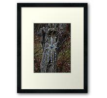 Ornament on a tree Framed Print