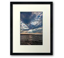 Sun shining thru clouds Framed Print
