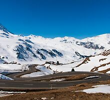A winding road on the Julier alpine pass  by Michael Brewer