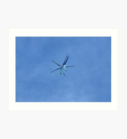 helicopter in blue sky Art Print
