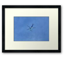 helicopter in blue sky Framed Print