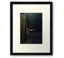 A dark street Framed Print