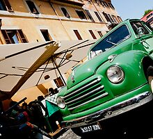 Green classic Fiat truck parked in Italian Street. by brians101