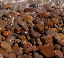 Abstract stones washed and round on beach. by brians101